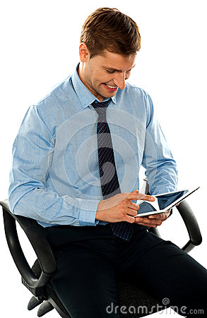 Businessman watching videos on tablet pc