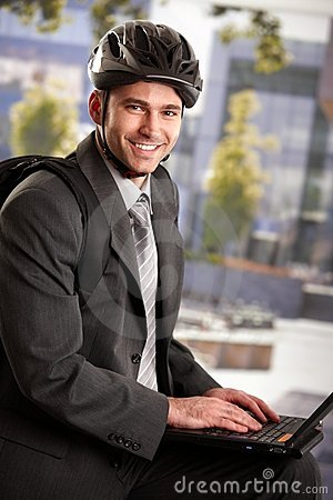 Businessman wearing bike helmet