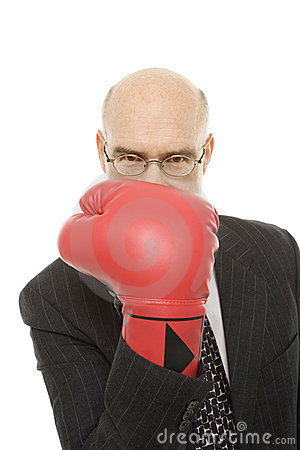 Businessman wearing boxing glove.