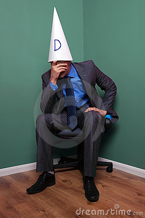 Businessman wearing a dunce hat