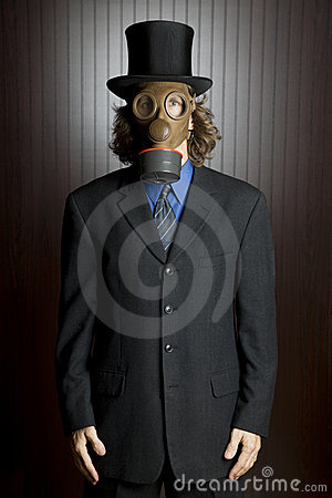 Businessman wearing a gas mask.