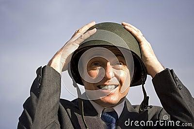 Businessman wearing helmet