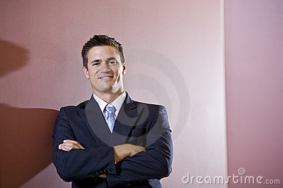 Businessman wearing suit with arms folded