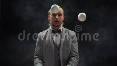 Businessman wearing a suit juggling white balls. Happy emotion in the end. Concept of Success and management.  stock footage