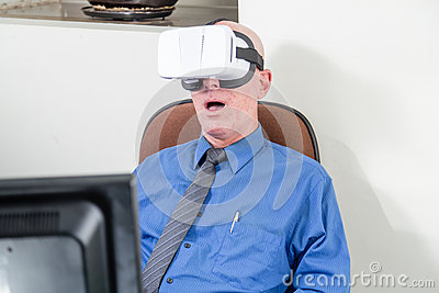 Businessman wearing VR headset, amazed