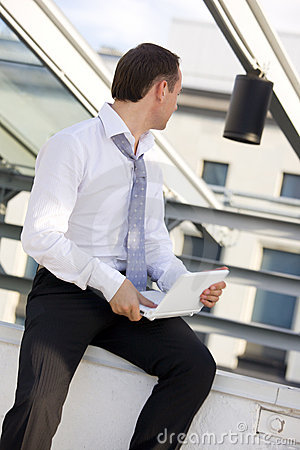 Businessman with white laptop computer