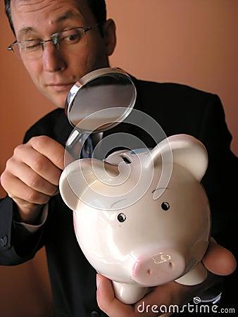 Free Businessman With A Piggy Bank Stock Photos - 2611163