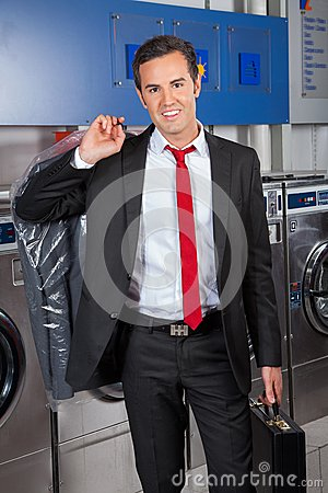 Free Businessman With Suitcase And Suitcover In Laundry Stock Photography - 37110822