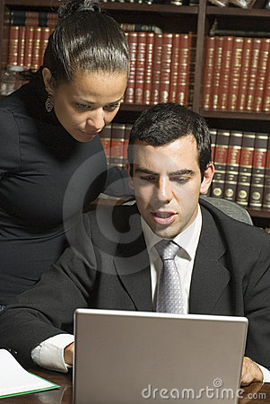 Businessman and Woman at Laptop - Vertical