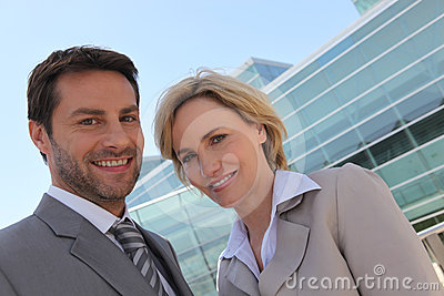 Businessman and woman outside.