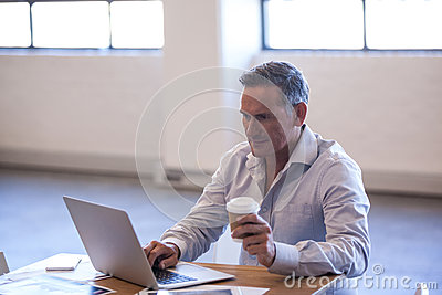 Businessman working on his laptop Stock Photo