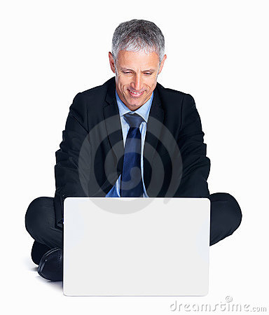 Businessman working on laptop isolated on white