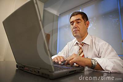 Businessman working laptop office environment