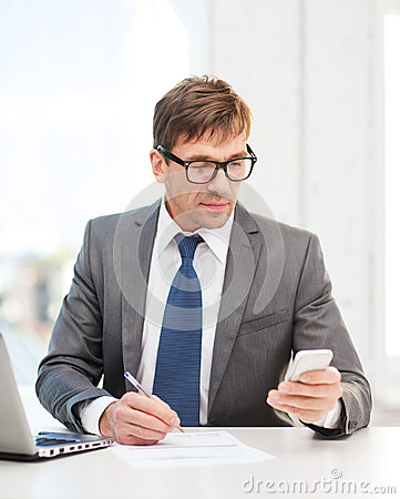 Businessman working with laptop and smartphone