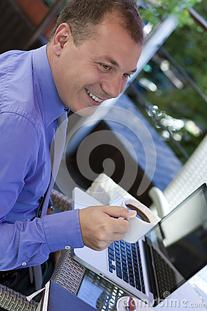 Businessman working outdoor, with laptop