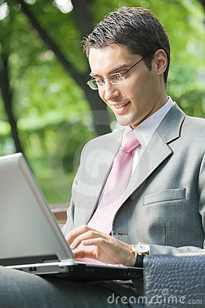 Businessman working, outdoors