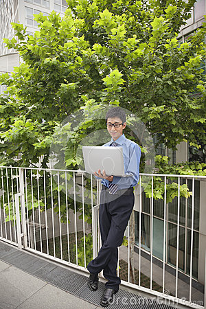 Businessman working outdoors with his laptop