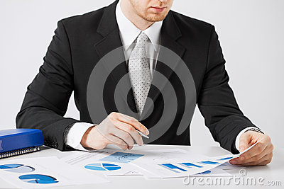 Businessman working and signing with papers