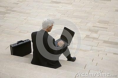 Businessman working on steps.