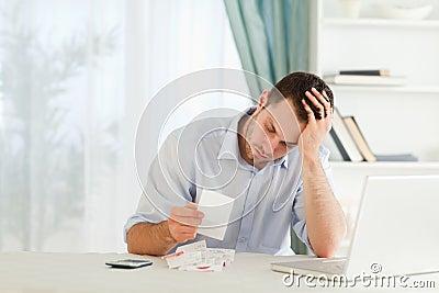 Businessman worried about bills