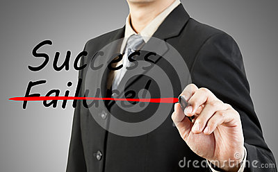 Businessman write the word success and failu
