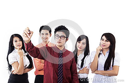 Businessman writing on copyspace with team