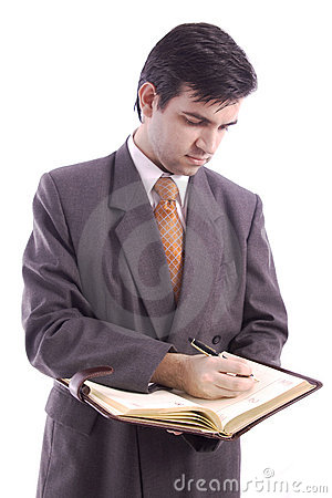 Businessman writing in his agenda
