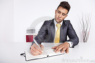 Businessman writing on the notepad
