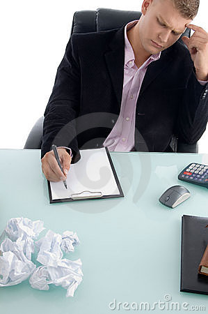 Businessman writing on paper pad