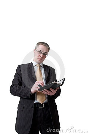 Businessman writing to notebook