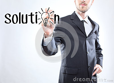 Businessman writing the word solution