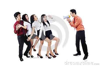 Businessman yelling at employees