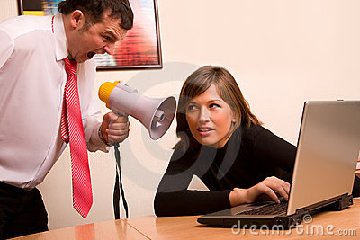 Businessman yelling on his associate at office