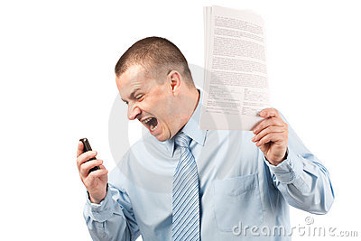 Businessman yelling on phone