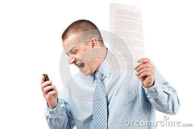 Businessman yelling on phone