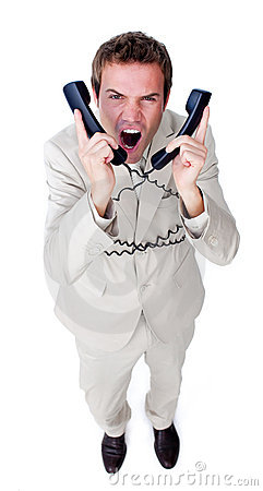 Businessman yelling tangled up in phone wires