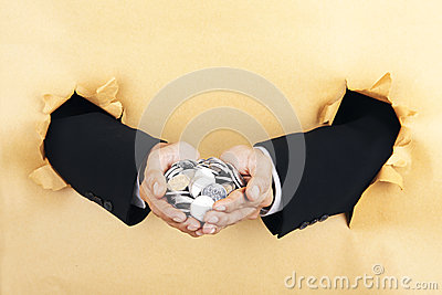 Businessmans hands holding coins