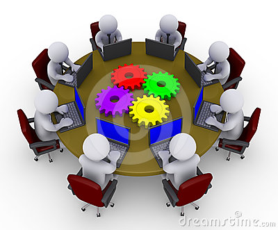 Businessmen around table with laptops and cogs