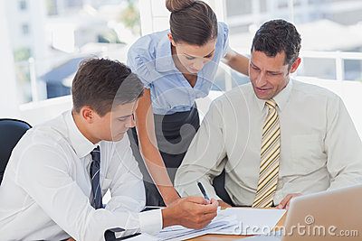 Businessmen and a businesswoman working together