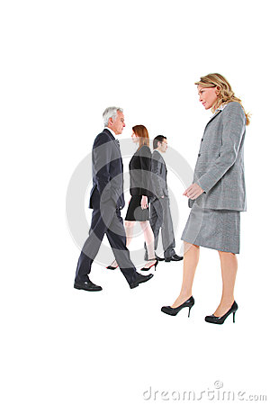 Businessmen and businesswomen walking