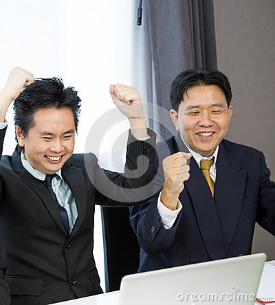 Businessmen celebrate