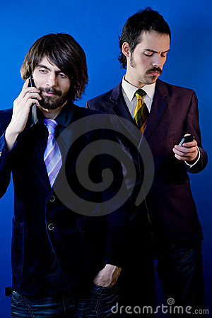 Businessmen with cellphones