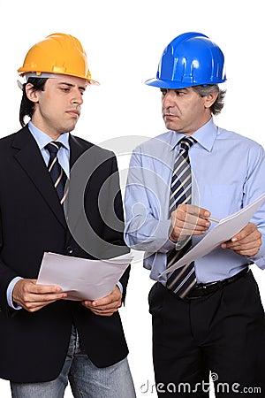 Businessmen debating