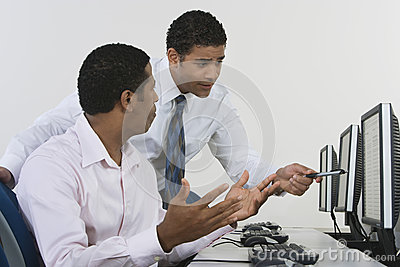 Businessmen Discussing In Computer Lab