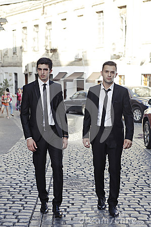 Businessmen friends on road