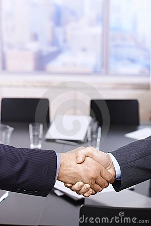 Businessmen handshake over table