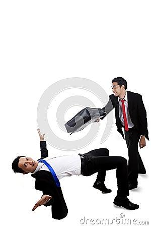 Businessmen having a fight