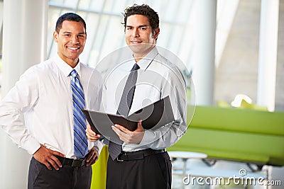 Businessmen Having Informal Meeting In Modern Office