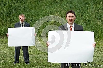 Businessmen holding sheet of paper