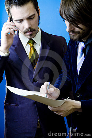 Businessmen inking a deal